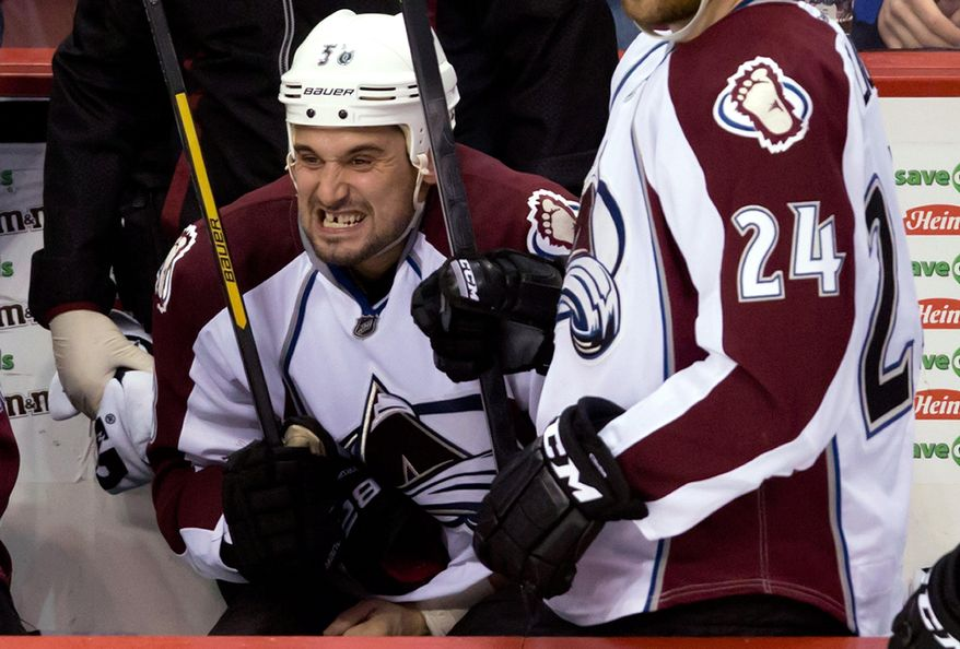 Colorado Avalanche's Patrick Bordeleau reacts on the bench after getting slashed during the third period of an NHL hockey game against the Vancouver Canucks on Thursday, April 10, 2014, in Vancouver, British Columbia. (AP Photo/The Canadian Press, Darryl Dyck)