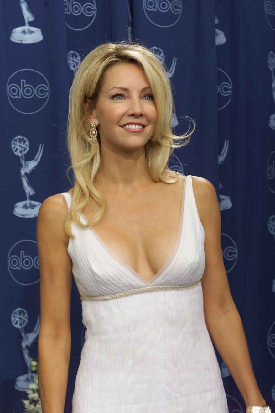 Heather Locklear poses backstage at the 52nd Annual Primetime Emmy Awards at the Shrine Auditorium in Los Angeles, Sunday, Sept. 10, 2000. (AP Photo/Kevork Djansezian)