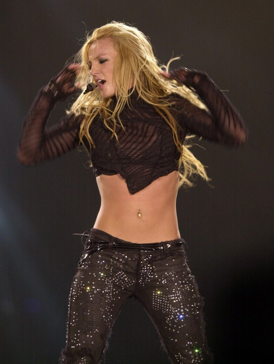 Pop singer  Britney Spears performs at Foro Sol Saturday July 27, 2002, in Mexico City. Spears will have two concerts  this weekend finishing her summer tour in Mexico.(AP Photo/Jose Luis Magana)