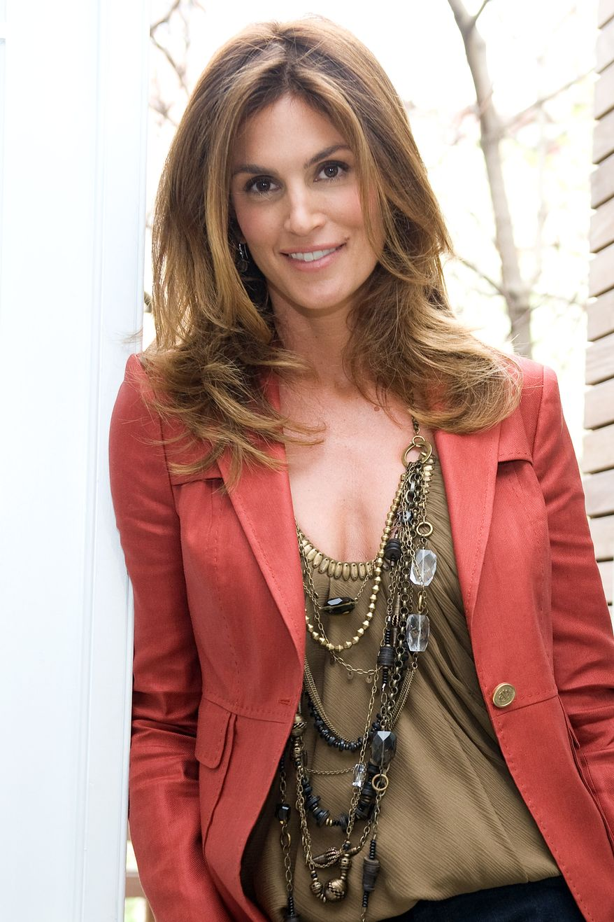 Cindy Crawford and JCPenney preview their new Cindy Crawford Home Collection in New York, April 21, 2009. The collection is available at JCPenney this fall with everything from bedding, drapes, decorative accessories, chairs, mirrors, area rugs, lighting and wall decor. (AP Photo/Charles Sykes)