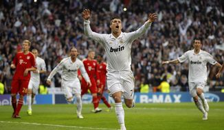 Real Madrid's Cristiano Ronaldo from Portugal celebrates after scoring during a semi final second leg Champions League soccer match against Bayern Munich at the Santiago Bernabeu stadium, in Madrid, Wednesday, April 25, 2012. (AP Photo/Daniel Ochoa de Olza)