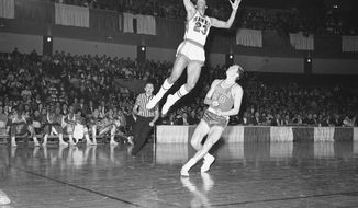 St. Louis Hawks rookie forward Lou Hudson (23) leaps to make a lay up against Philadelphia in St. Louis, on Jan. 31, 1967. Rookie Bill Melchionni seems to know better than to try to stop Hudson. (AP Photo)