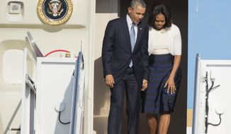 President Barack Obama and first lady Michelle Obama disembark from Air Force One as they arrive Andrews Air Force Base, Md., Thursday, April 10,  2014, from a trip in Texas.  (AP Photo/Manuel Balce Ceneta)