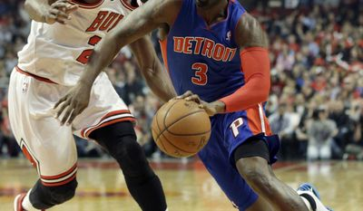 Detroit Pistons guard Rodney Stuckey, right, drives to the basket as Chicago Bulls guard Jimmy Butler guards during the first half of an NBA basketball game in Chicago on Friday, April 11, 2014. (AP Photo/Nam Y. Huh)
