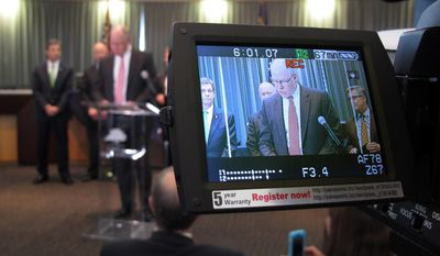 John Strong, FBI special agent in charge of North Carolina, is displayed on a camera monitor as he addresses the media during a news conference at the Wake Forest Town Hall on Thursday, April 10, 2014, in Wake Forest, N.C. Strong said the kidnapping of Frank Arthur Janssen was related to his daughter's prosecution of North Carolina prisoner Kelvin Melton, who is serving a life sentence for his 2012 conviction for being a habitual felon. Melton, 49, was also convicted of assault with a deadly weapon with intent to kill.  (AP Photo/Allen G. Breed)