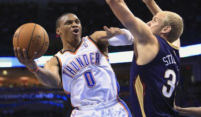 Oklahoma City Thunder guard Russell Westbrook (0) goes to the basket around New Orleans Pelicans center Greg Stiemsma (34) during the first quarter of a NBA basketball game in Oklahoma City, Friday, April 11, 2014. (AP Photo/Alonzo Adams)