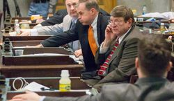 Lawmakers cast votes during a floor debate about the state's annual spending plan in Nashville, Tenn. on Thursday, April 10, 2014. From left are Republican Reps. Paul Bailey of Sparta, Bill Dunn of Knoxville and Harry Brooks of Knoxville. (AP Photo/Erik Schelzig)