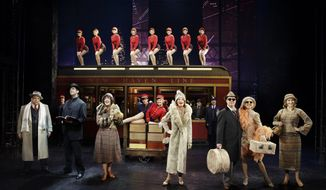 "In this undated Boneau/Bryan-Brown-provided photo, Vincent Pastore, Nick Cordero, Karen Ziemba, Marin Mazzie, Brooks Ashmanskas, Helene Yorke and Betsy Wolfe with the cast of ""Bullets Over Broadway"" pose for a photo at the St. James Theatre, in New York. The new musical ""Bullets Over Broadway"" begins with a mafia goon firing a machine gun into the theater curtain, spelling out the title of the show. (AP Photo/Boneau/Bryan-Brown, Paul Kolnik)"