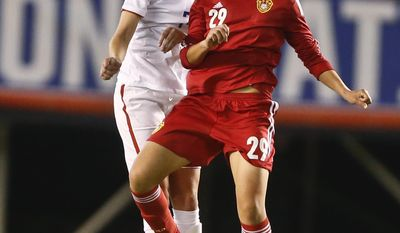 China forward Yang Li and U.S. midfielder Morgan Brian vie for a head ball during the first half of an international friendly soccer match Thursday, April 10, 2014, in San Diego. (AP Photo/Lenny Ignelzi)