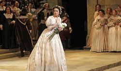 """This image released by the Metropolitan Opera shows Olga Peretyatko during a dress rehearsal at the Metropolitan Opera in New York, for Vincenzo Bellini's """"I Puritani."""" The production opens on April 17 for a run of seven performances, ending on the last night of the season, May 10. (AP Photo/Metropolitan Opera, Ken Howard)"""