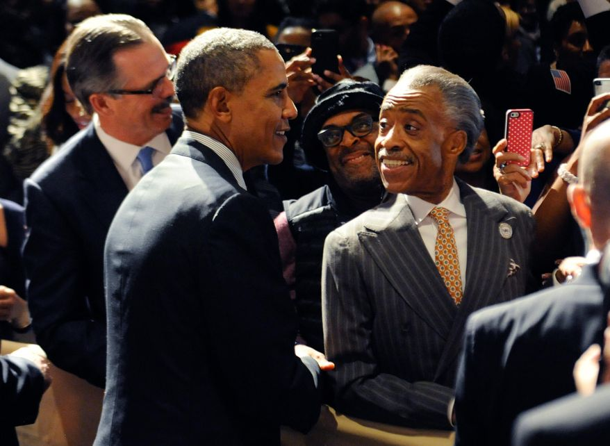 """Kira Davis urges black Democrats to question """"lockstep"""" party loyalty. Above: President Obama and Rev. Al Sharpton at the 2014 National Action Network conference in New York. (AP Photo/The Daily News, Julia Xanthos, Pool)"""