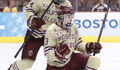 Boston College's Johnny Gaudreau, right, celebrates his goal with teammate Bill Arnold, left, during the first period of an NCAA men's college hockey Frozen Four tournament game against Union, Thursday, April 10, 2014, in Philadelphia. (AP Photo/Chris Szagola)