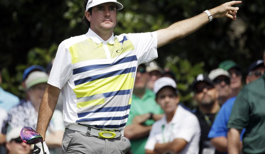 Bubba Watson points to his tee shot on the ninth hole during the second round of the Masters golf tournament Friday, April 11, 2014, in Augusta, Ga. (AP Photo/Darron Cummings)