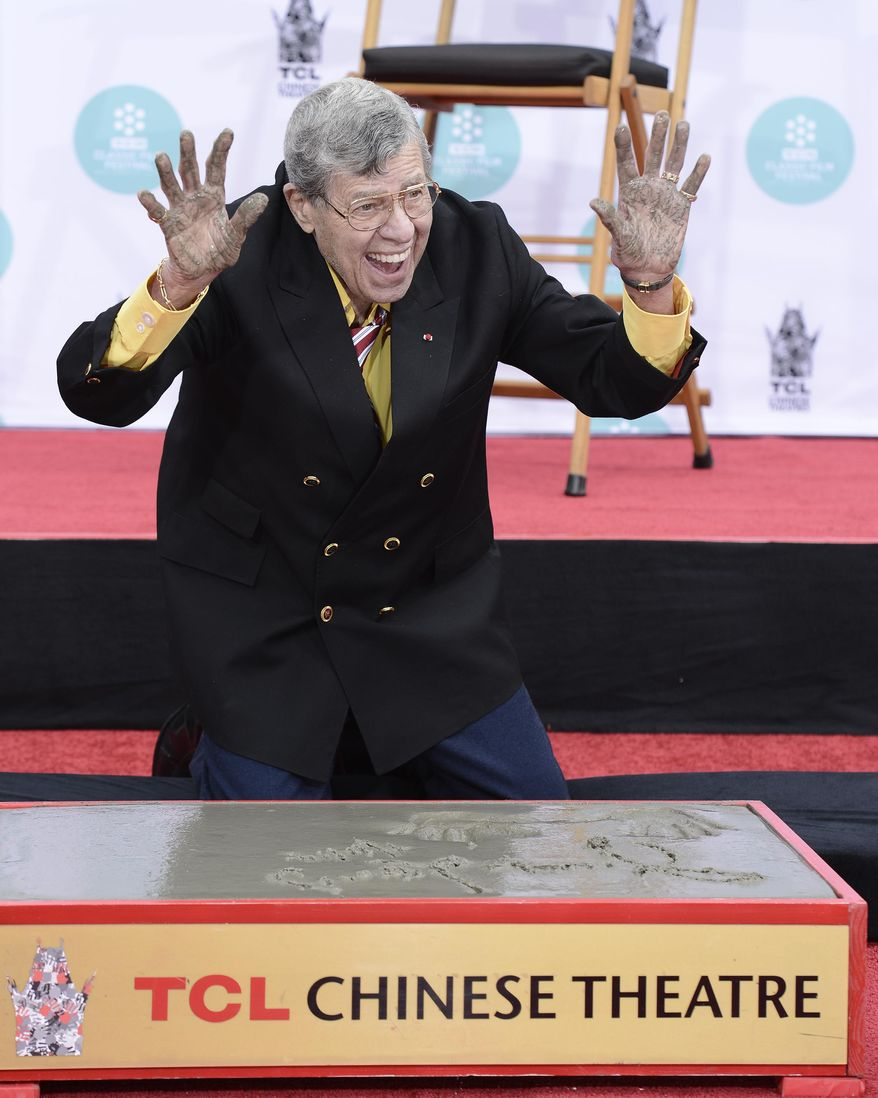 Actor and comedian Jerry Lewis is honored with a hand and footprint ceremony at TCL Chinese Theatre on Saturday, April 12, 2014 in Los Angeles. (Photo by Dan Steinberg/Invision/AP Images)