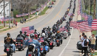 Members of the Rolla Patriot Guard Riders travel along the procession route on 10th Street in Rolla, Mo., after the funeral service of Sgt. Timothy Owens, 37, of Effingham, Ill., Saturday, April 12, 2014. Owens was a soldier killed in shootings at Fort Hood, Texas, earlier this month. (AP Photo/Rolla Daily News, Paul Hackbarth)