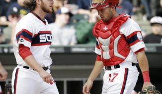 Chicago White Sox relief pitcher Daniel Webb, left, and catcher Adrian Nieto react after Cleveland Indians' Ryan Raburn hit a two-run single during the seventh inning of a baseball game in Chicago on Saturday, April 12, 2014. (AP Photo/Nam Y. Huh)