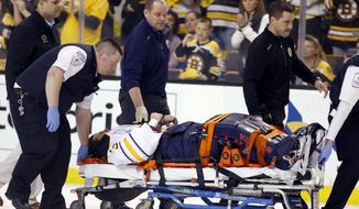 Buffalo Sabres' Matt Hackett (31) is carted off the ice on a stretcher after getting injured in the third period of an NHL hockey game against the Boston Bruins in Boston, Saturday, April 12, 2014. The Bruins won 4-1. (AP Photo/Michael Dwyer)