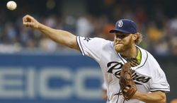 San Diego Padres starting pitcher Andrew Cashner works against the Detroit Tigers during the first inning of a baseball game Friday, April 11, 2014, in San Diego. (AP Photo/Lenny Ignelzi)