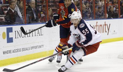 Columbus Blue Jackets center Mark Letestu (55) skates with the puck as Florida Panthers defenseman Ed Jovanovski (55) pursues in the first period of a hockey game, Saturday, April 12, 2014, in Sunrise, Fla. (AP Photo/Lynne Sladky)