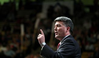 **FILE** Colorado Rep. Cory Gardner delivers a speech to Republican delegates at state GOP Congress in Boulder on April 12, 2014. Gardner is stepping down from his current House seat to challenge Democratic U.S. Sen. Mark Udall in November. (Associated Press)
