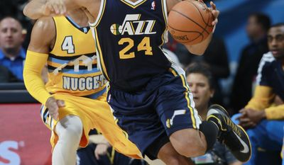 Utah Jazz forward Richard Jefferson, front, works inside for a shot past Denver Nuggets guard Randy Foye in the first quarter of an NBA basketball game in Denver on Saturday, April 12, 2014. (AP Photo/David Zalubowski)