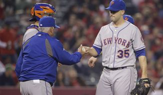 New York Mets starting pitcher Dillon Gee, right, hands the ball to manager Terry Collins as he is relieved during the sixth inning of a baseball game against the Los Angeles Angels on Friday, April 11, 2014, in Anaheim, Calif. (AP Photo/Jae C. Hong)
