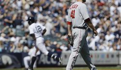 Boston Red Sox starting pitcher John Lackey (41) walks the infield as New York Yankees' Alfonso Soriano (12) runs the bases after hitting a home run during the fourth inning of a baseball game Saturday, April 12, 2014, in New York. (AP Photo/Frank Franklin II)