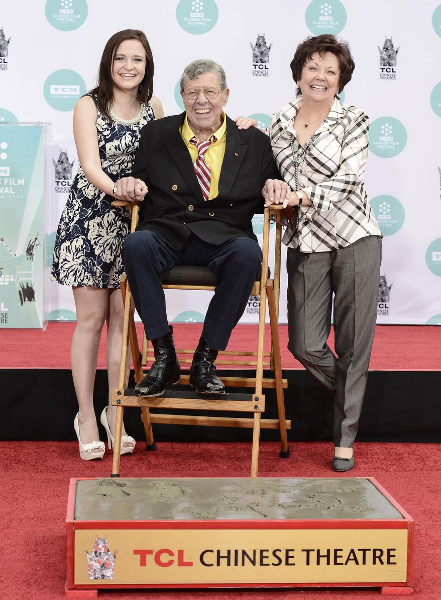 Actor and comedian Jerry Lewis, center, his wife, SanDee Pitnick, right, and his daughter Danielle Lewis pose together as he is honored with a hand and footprint ceremony at TCL Chinese Theatre on Saturday, April 12, 2014 in Los Angeles. (Photo by Dan Steinberg/Invision/AP Images)