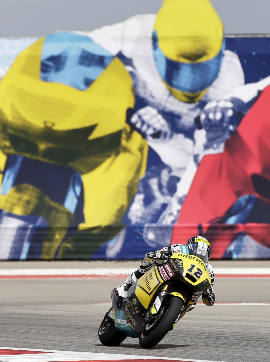 Luthi Thomas, of Switzerland, comes out of a turn during open practice for the Grand Prix of the Americas MotoGP motorcycle race, Saturday, April 12, 2014, in Austin, Texas. (AP Photo/Tony Gutierrez)