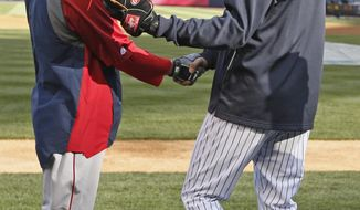 New York Yankees shortstop Derek Jeter, right, greets Boston Red Sox second baseman Dustin Pedroia before a baseball game at Yankee Stadium in New York, Thursday, April 10, 2014.  (AP Photo/Kathy Willens)