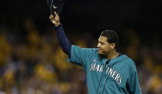 Seattle Mariners starting pitcher Felix Hernandez tips his cap to fans as he leaves a baseball game against the Oakland Athletics in the eighth inning, Friday, April 11, 2014, in Seattle. Hernandez struck out 11 batters and allowed no runs. (AP Photo/Ted S. Warren)