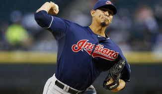 Cleveland Indians starting pitcher Carlos Carrasco delivers against the Chicago White Sox during the first inning of a baseball game on Friday, April 11, 2014, in Chicago. (AP Photo/Andrew A. Nelles)