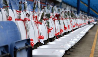 Ninety six blue seats at Hillsborough stadium are replaced by white seats to represent the 96  Liverpool fans who died at the Hillsborough disaster 25 years ago, ahead of the Championship soccer match between Sheffield Wednesday and Blackburn Rovers at Hillsborough, Sheffield, Saturday April 12, 2014. (AP Photo/PA) UNITED KINGDOM OUT  NO SALES  NO ARCHIVE