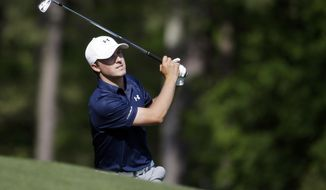 Jordan Spieth watches his tee shot on the 12th hole during the third round of the Masters golf tournament Saturday, April 12, 2014, in Augusta, Ga. (AP Photo/Darron Cummings)