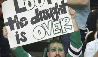 A Dallas Stars fan holds up a sign after an NHL hockey game between the St. Louis Blues and the Dallas Stars on Friday, April 11, 2014, in Dallas. The Stars won 3-0. (AP Photo/LM Otero)