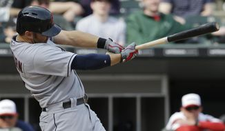 Cleveland Indians' Ryan Raburn hits a two-run single against the Chicago White Sox during the seventh inning of a baseball game in Chicago on Saturday, April 12, 2014. (AP Photo/Nam Y. Huh)