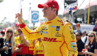Ryan Hunter-Reay gestures after winning the pole position at IndyCar qualifying for the Grand Prix of Long Beach auto race on Saturday, April 12, 2014, in Long Beach, Calif. (AP Photo/Alex Gallardo)