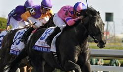 Jockey Corey Nakatani, right, rides Dance With Fate to victory over Medal Count, left, ridden by jockey Robby Albarado, in the Blue Grass Stakes horse race at Keeneland in Lexington, Ky., Saturday, April 12, 2014. (AP Photo/Garry Jones)