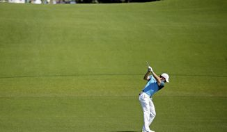 Rory McIlroy, of Northern Ireland, prepares to hit on the eighth fairway during the third round of the Masters golf tournament Saturday, April 12, 2014, in Augusta, Ga. (AP Photo/Chris Carlson)