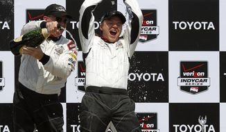 Brett Davern, right, celebrates after winning the Pro/Celebrity Grand Prix of Long Beach auto race with Al Unser, Jr. on Saturday, April 12, 2014, in Long Beach, Calif. Davern won the celebrity part of the race and Unser won the pro part. (AP Photo/Alex Gallardo)