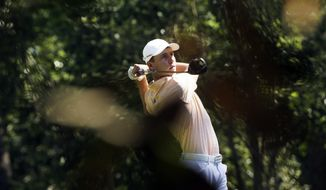 Oliver Goss, of Australia, tees off on the second hole during the third round of the Masters golf tournament Saturday, April 12, 2014, in Augusta, Ga. (AP Photo/David J. Phillip)