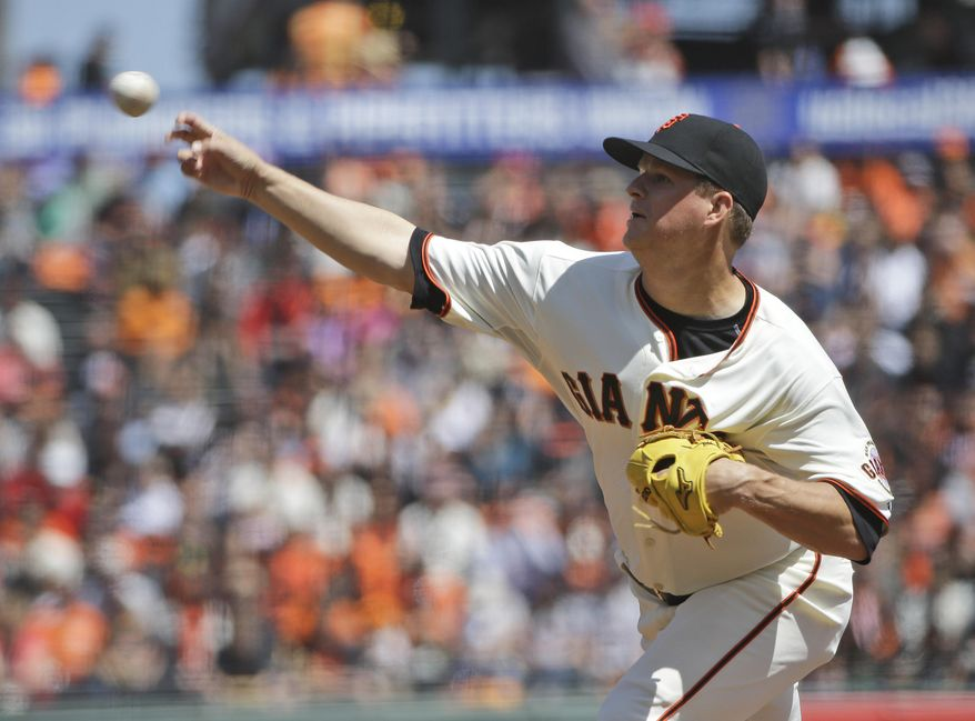 San Francisco Giants starting pitcher Matt Cain throws to the Colorado Rockies during the first inning of a baseball game on Saturday, April 12, 2014, in San Francisco. (AP Photo/Marcio Jose Sanchez)