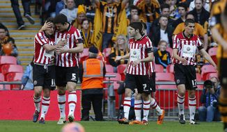 Sheffield United's Jose Baxter, left, celebrates his goal against Hull City with teammates during their English FA Cup semifinal soccer match at Wembley Stadium in London, Sunday, April 13, 2014. (AP Photo/Sang Tan)