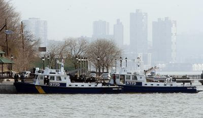 Police divers found the bodies of two people in the Hudson River near Sinatra Park after a search by units from New York City and New Jersey began, Sunday, April 13, 2014, in Hoboken, N.J.  (AP Photo/Joe Epstein)