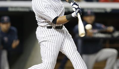 New York Yankees right fielder Carlos Beltran hits a seventh-inning double chasing Boston Red Sox starting pitcher Felix Doubront from a baseball game between the two American League East teams at Yankee Stadium in New York, Sunday, April 13, 2014.  (AP Photo/Kathy Willens)