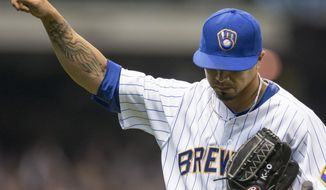 Milwaukee Brewers' Kyle Lohse acknowledges the crowd after pitching against the Pittsburgh Pirates, Sunday, April 13, 2014, in Milwaukee. (AP Photo/Tom Lynn)
