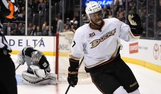 Anaheim Ducks right wing Devante Smith-Pelly, right, celebrates after scoring on Los Angeles Kings goalie Jonathan Quick in the shootout of an NHL hockey game, Saturday, April 12, 2014, in Los Angeles. The Ducks won 4-3. (AP Photo/Mark J. Terrill)