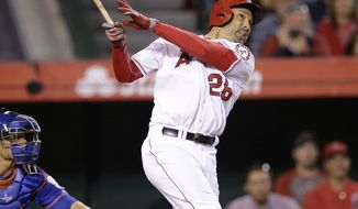 Los Angeles Angels' Raul Ibanez watches his three-run home run during the ninth inning of a baseball game against the New York Mets on Saturday, April 12, 2014, in Anaheim, Calif. (AP Photo/Jae C. Hong)