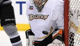 Anaheim Ducks goalie Frederik Andersen, of Denmark, stops a shot during the second period of an NHL hockey game against the Los Angeles Kings, Saturday, April 12, 2014, in Los Angeles. (AP Photo/Mark J. Terrill)