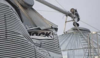 Corn silos are damaged on the Morey farm on Sunday, April 13, 2014 in the Swartz Creek, Mich., area after a severe windstorm Saturday.   A wave of severe thunderstorms has blown across the southern half of Michigan, knocking out power to at least 174,000 homes and businesses and shutting down parts of two interstate highways because of fallen power lines.  (AP Photo/The Flint Journal, Samuel Wilson ) LOCAL TV OUT; LOCAL INTERNET OUT